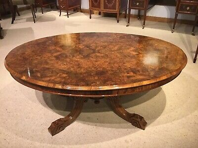A burr walnut Victorian Period oval antique coffee table