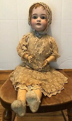 Antique doll Marked CMB SH about 24 inches long with teeth