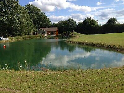Secluded Lakeside Log Cabin with hot tub and fly fishing. August Bank Holiday