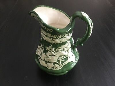 Vintage Pottery Embossed American Colonial Design Dark Green and White Pitcher