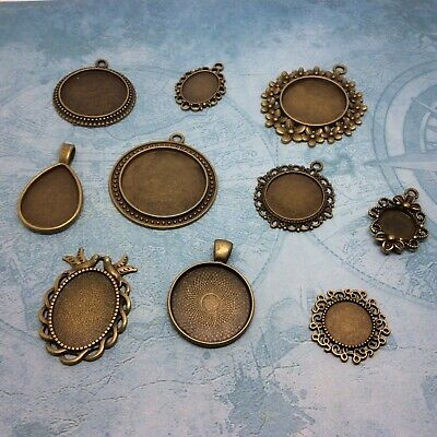 10 sets of vintage mix bronze cabochon tray settings and glass round oval drop