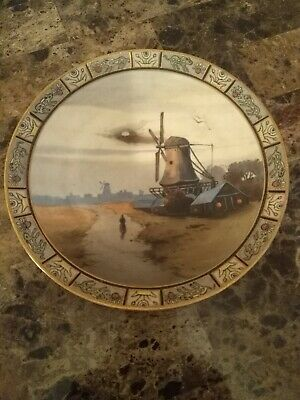Very rare hard to find.FINE ANTIQUE NIPPON HAND PAINTED DUTCH LADY and windmill.