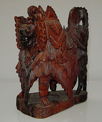 Chinese Ming style Huanghuali carved buddhistic temple lion, late C19th/early 20