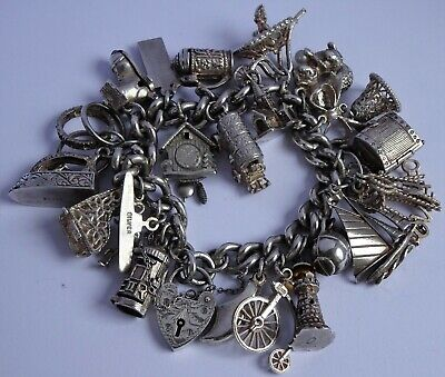 Wonderful vintage solid silver charm bracelet & 22 charms.Rare,open,move. 102.8g