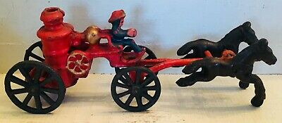 Vintage antique painted cast iron fireman with horses firefighter