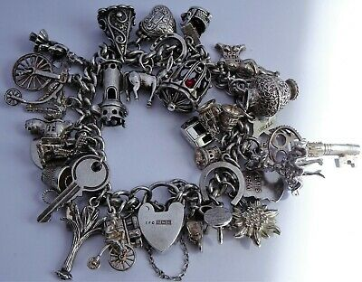 Stunning heavy vintage solid silver charm bracelet & 32 charms. Rare,open,move
