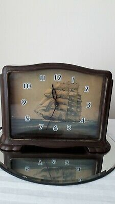 bakerlite clock with ship decoration 7 inches wide by 5 1/2 inches high