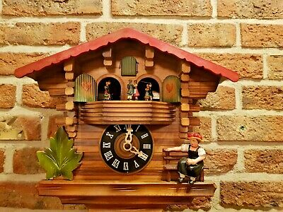 Vintage Black Forest Chalet Cuckoo Clock with Music and dancing figurines at top