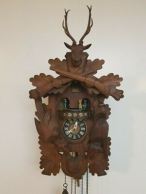 Vintage Black Forest Hunt Cuckoo Clock with Music box and dancing figurines