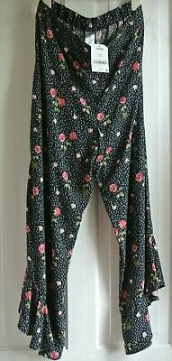 New Next girls trousers Black floral age 13