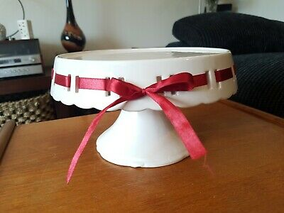 Gorgeous Scalloped White Pierced Ceramic Pedestal Cake Stand with Red Ribbon