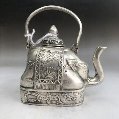 Chinese ancient Tibetan silver wine pot pure hand-carved elephant model.