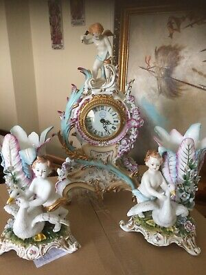 Antique fine porcelain clock garniture