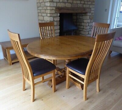 Antique effect single pedestal pine table (extendable) with four pine chairs