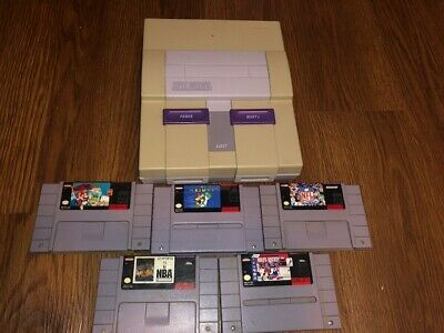 Super Nintendo Entertainment System Console - with 5 games + controllers