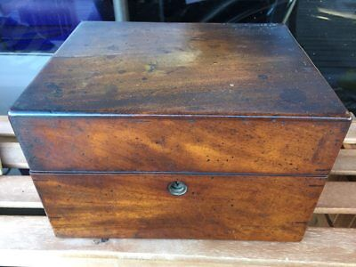 Antique Medical chest as shown with various items.