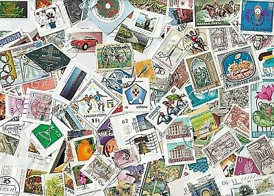 World wide collection...35 grams used stamps on and off paper