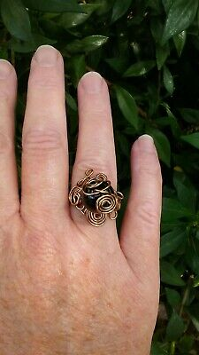 copper wire ring with antique bronze finish, onyx polished sphere bead.