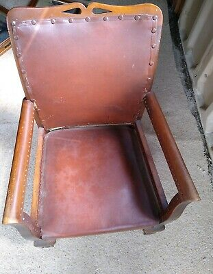 Antique child's wood and leather chair with studs and ball and claw front legs