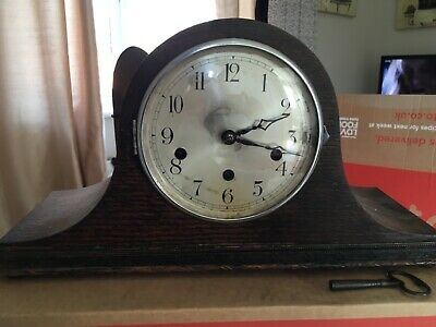 mantel clock in working order, chimes and has pendulum and key.