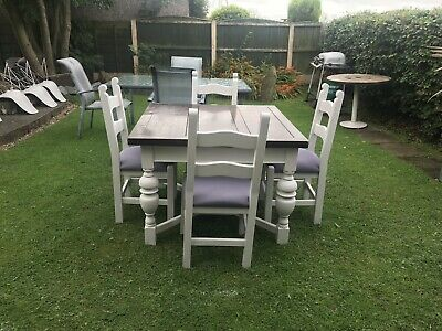 solid oak extending dining table. And Four Solid Oak Chairs
