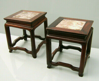 A pair of C19th huanghuali and marble inset table form miniature stands Qing
