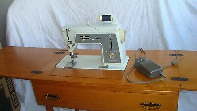 Singer 600 E Touch & Sew Deluxe Zig Zag Sewing Machine with cabinet and more!