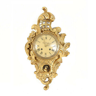 Rococo style wall clock from 1900.