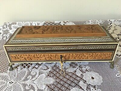 Vintage Indian carved wooden and inlaid box with brass feet and key