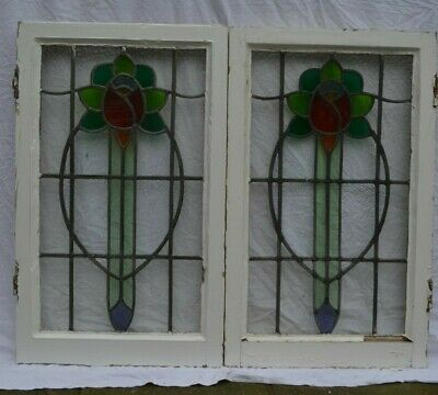 TWO frame 470 x 770mm. Stained glass rose leaded light window sashes. R959 x2.