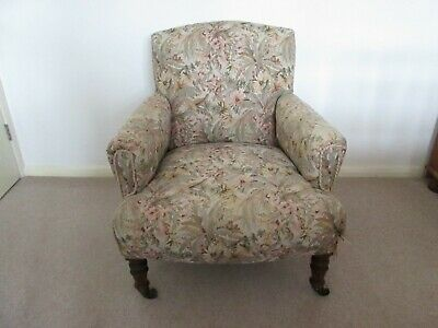 Antique upholstered small armchair.