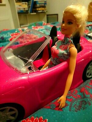 Barbie convertible pink 2 seater sports car and Barbie doll set with seatbelts