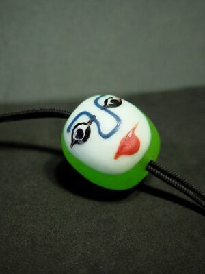 ANTIQUE PHOENICIAN OR ISLAMIC GLASS BEAD DOUBLE-FACE PENDANT. CIRCA 1900's
