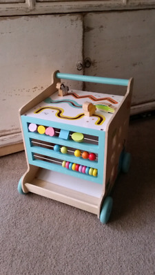 Wooden activity cube and walker