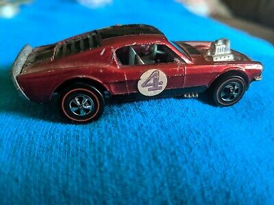 Vintage 1969 Hot Wheels Redline Mustang Boss Hoss light red, all original.