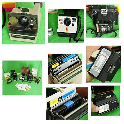 Collection of vintage Polaroid Cameras and accesories