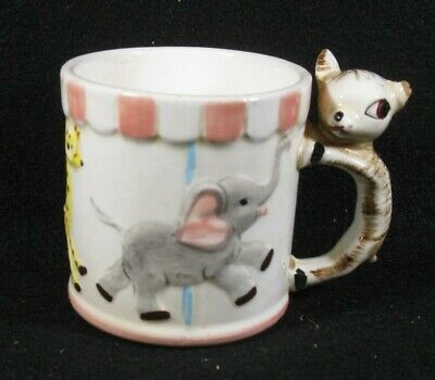 """Vintage Child's Carousel """"All Gone"""" cup with cat handle"""