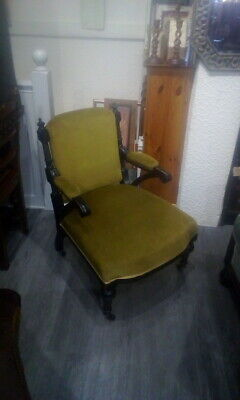Antique Ebony Upholstered Victorian Arm Chair With Original Castors