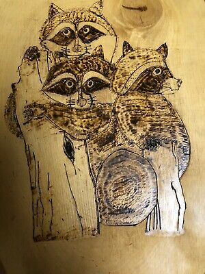 Vintage Raccoon family burnished into tree slab dated 1986