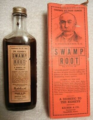Dr. KILMERS MEDICINE SHOW SWAP ROOT BOTTLE WITH CONTENTS IN ORANGE BOX