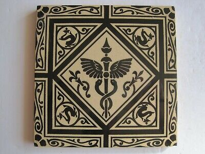 ANTIQUE VICTORIAN MINTONS BLACK ON BUFF CADUCEUS DESIGN WALL TILE c1868-1900