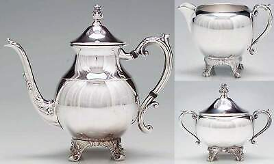 Mid-century FB Rogers silver-plate on copper tea service. Teapot, creamer, sugar