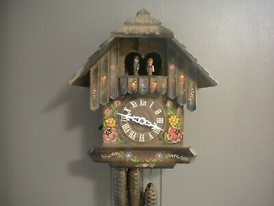 Musical 30 hour  Cuckoo Clock~Runs plays 2 songs  male and female  dancers