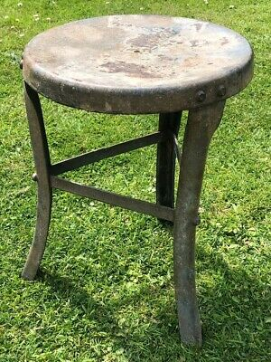 Old vintage industrial agricultural galvanised metal milking stool