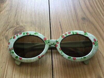 Pretty girls' blue strawberry design sun glasses (2-3 years approx), pre-owned.