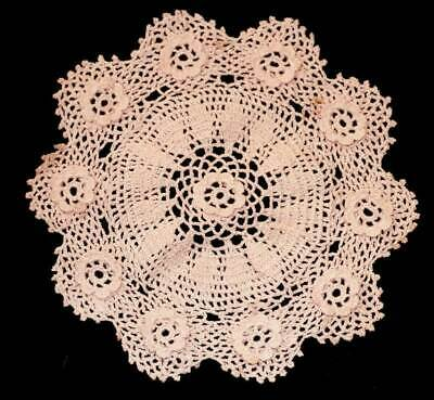 Pink doily with raised flower detail. Measures approx 21cm across.