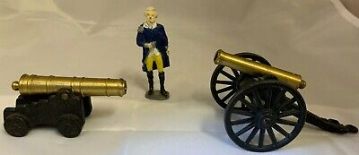 Two Vintage Miniature Brass and Cast Iron Cannons and One Lead General Figurine.