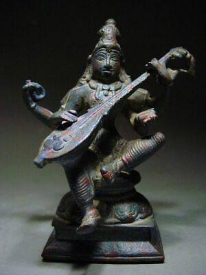 ANTIQUE BRONZE STATUE OF A FEMALE MULTI-ARMED HINDU GODDESS SARASWATI. 17/18th C