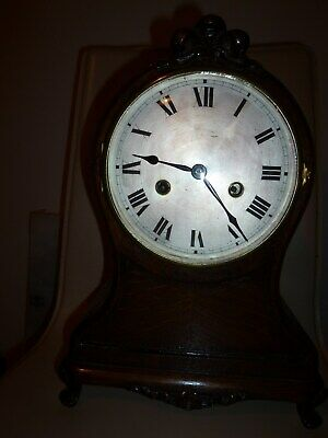 ANTIQUE WOODEN MANTLE CLOCK.  Lovely old, oak-cased clock. Delightful tall shape