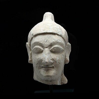 A Cypriot Limestone Head of a Youth, Archaic Period, 600-500 BCE